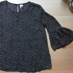 black shirt with small white polka dots by elle